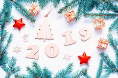 New Year 2019 card - 2019 figures,Christmas toys, fir branches. Flat lay, top view, New Year 2019 still life stock photography