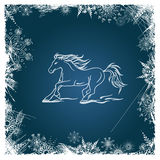 New Year card with horse framed by snowflakes Royalty Free Stock Photography