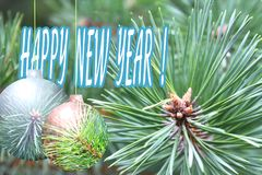 New Year card with the inscription: Happy New Year. Christmas tree and abstract Christmas balls Stock Photo