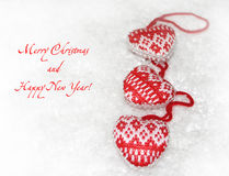 New Year card with knitted hearts Stock Images