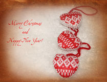 New Year card with knitted hearts Stock Image