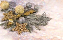 New Year card. New Year`s design. Silver, gold balls and stars and gold balls. New Year card. Christmas decoration, a wreath of fir branches, glass balls and royalty free stock images