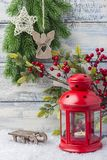 New Year card. Red candlestick and sprig Christmas tree. The theme of the new year and Christmas. New Year card. Red candlestick and sprig Christmas tree. The Royalty Free Stock Photography