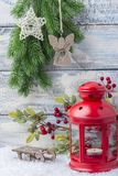 New Year card. Red candlestick and sprig Christmas tree. The theme of the new year and Christmas. New Year card. Red candlestick and sprig Christmas tree. The Stock Images