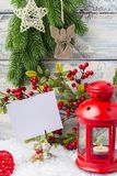 New Year card. Red candlestick and sprig Christmas tree. The theme of the new year and Christmas. Empty space for text Royalty Free Stock Image