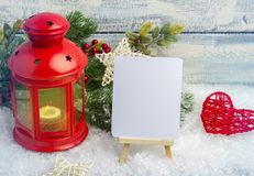 New Year card. Red candlestick and sprig Christmas tree. The theme of the new year and Christmas. Empty space for text Stock Image