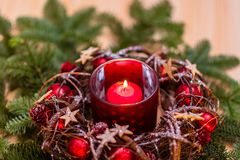 New Year card. Red Christmas candle in red New Year`s design stock photography