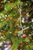 New Year card. Strawberries hanging on a spruce branch. Royalty Free Stock Photos