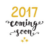 New Year card. 2017 year coming soon. Unique hand lettering in golden and black colors. Trendy typography design for placards, posters, flyers, banners. Modern Royalty Free Stock Photos