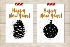 New Year cards set. Hand drawn textured New Year cards set with pine cone and Christmas tree ball vector illustrations Stock Photos