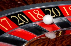 New Year 2018 casino roulette wheel lucky red sector eighteen 18. New Year 2018 classic casino roulette wheel with lucky red sector eighteen 18 and white ball Royalty Free Stock Photos