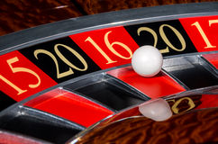 2016 New Year casino roulette wheel red sector sixteen 16. New Year 2016 classic casino roulette wheel with red sector sixteen 16 and white ball and sectors 20 Royalty Free Stock Photos