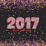 New Year 2017 celebration background with confetti. New Year 2017 celebration background. Happy New Year colorful digital type on black background with confetti Stock Photography