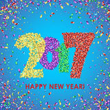 New Year 2017 celebration background with confetti. New Year 2017 celebration background. Happy New Year colorful digital type on blue background with confetti Royalty Free Stock Photos
