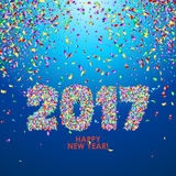 New Year 2017 celebration background with confetti. New Year 2017 celebration background. Happy New Year colorful digital type on blue background with confetti Royalty Free Stock Photo