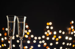 New Year Celebration. Champagne for festive occasions against a dark background with gold shimmering light and bokeh Stock Images