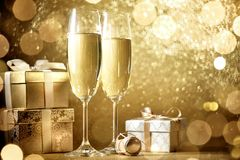 New year celebration. With champagne and gift Stock Photo