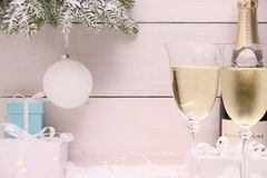 New Year Celebration with Champagne glass in white. New Year Celebration with Champagne glass on white wooden background Royalty Free Stock Photography