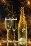 New Year celebration. With champagne and sparkler stock images