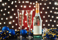 New Year Celebration. Christmas and New Year celebration with champagne. New Year holiday decorated table. Two Champagne Glasses against a dark background with Royalty Free Stock Photos