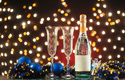 New Year Celebration. Christmas and New Year celebration with champagne. New Year holiday decorated table. Two Champagne Glasses against a dark background with royalty free stock image