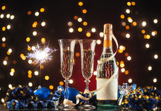 New Year Celebration. Christmas and New Year celebration with champagne. New Year holiday decorated table. Two Champagne Glasses against a dark background with Stock Photography