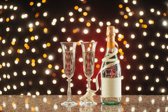 New Year Celebration. Christmas and New Year celebration with champagne. Pair of flute and bottle of Champagne for festive occasions against a dark background Royalty Free Stock Photography