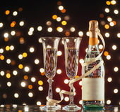 New Year Celebration. Christmas and New Year celebration with champagne. Pair of flute and bottle of Champagne for festive occasions against a dark background Stock Image