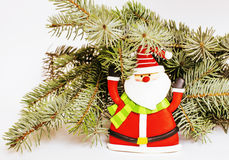 New year celebration, Christmas holiday stuff, tree, toys, decor. Ation with snow isolated, santas red hat Stock Photos