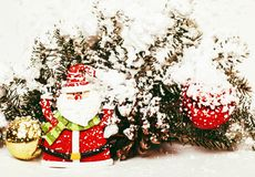 New year celebration, Christmas holiday stuff, tree, toys, decoration with snow, santas red hat Royalty Free Stock Photos