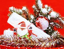 New year celebration, Christmas holiday stuff, tree, toys, decoration with snow , santas red hat Stock Photo