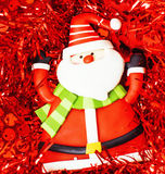 New year celebration, Christmas holiday stuff, tree, toys, decoration with snow , santas red hat. Close up Royalty Free Stock Photos