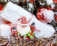 New year celebration, Christmas holiday stuff, tree, toys, decoration with snow, santas red hat stock photography