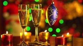 New Year Celebration. Christmas.Two Champagne. Glasses on Holiday Setting Table stock video footage