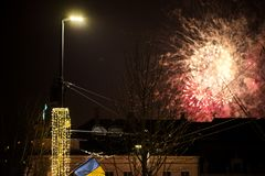 New Year celebration. Colorful, beautiful fireworks on the night sky over the city. New Year celebration. Blurry, falling stars stock photo