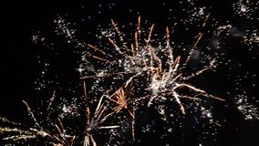 New Year celebration colorful fireworks. Glowing, multicolored and sparkle firework on the sky by night. Fireworks display in the stock video
