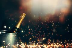 New Year 2019 Celebration Concept. Bottle of champagne on a background of holiday lights design stock photos