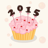 New Year celebration with cup cake. Royalty Free Stock Images