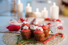 New Year celebration cupcakes, chocolate muffins on table. New Year celebration cupcakes, chocolate muffins on the table Royalty Free Stock Photos