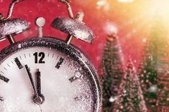 New Year - Celebration With Dial Clock. On Snow And Trees Royalty Free Stock Photo