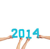 2014 New Year celebration. With female hands holding turquoise numbers with the date isolated on a white background with copyspace for your greeting or party Stock Images