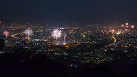 New Year Celebration Fireworks Over CityScape Of Chiang Mai, Thailand