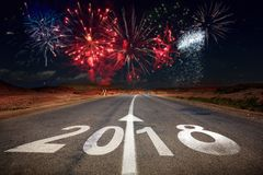 2018 New Year celebration fireworks on the road. Asphalt. New Year arrival concept Stock Photos