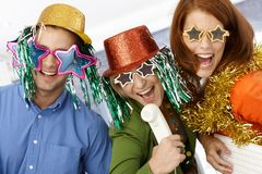 New year celebration in office. Office workers in party hat and funny sunglasses having fun stock photos