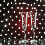 New Year Celebration. Pair of champagne flutes over background of lights Royalty Free Stock Photos