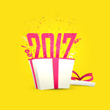 New Year 2017 celebration Poster or Banner. Text 2017 coming out from a gift box on yellow background, Happy New Year celebration poster, banner or flyer design Stock Image