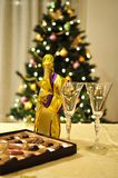 New year celebration setting. With a bottle of champagne with two galsses and sweets stock image