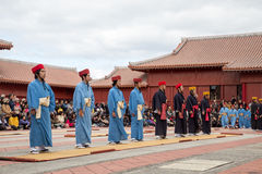 New Year celebration at Shuri castle in Okinawa, Japan. Okinawa, Japan - January 02, 2015: Dressed-up people performing a show for spectators at the traditional Stock Image