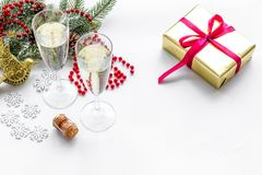 New Year 2018 celebration with spruce branch, champagne in glasses and present in box on white background mock up Royalty Free Stock Image