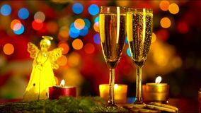 New Year Celebration. with Two Champagne Glasses. New Year Celebration. Two Champagne Glasses over New Year Tree Lights stock footage